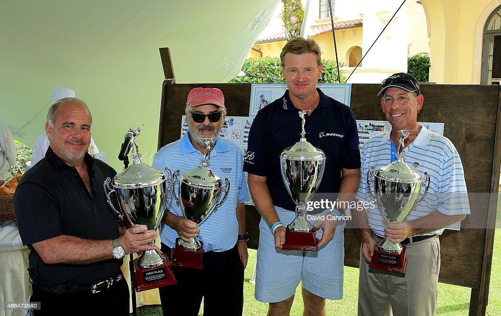 Members of the winning team with Marvin Shnaken of the USA (second from right) and Ernie Els of South Africa (second from left) during the Ernie Els Els for Autism pro-am on March 9, 2015 in West Palm Beach, Florida.
