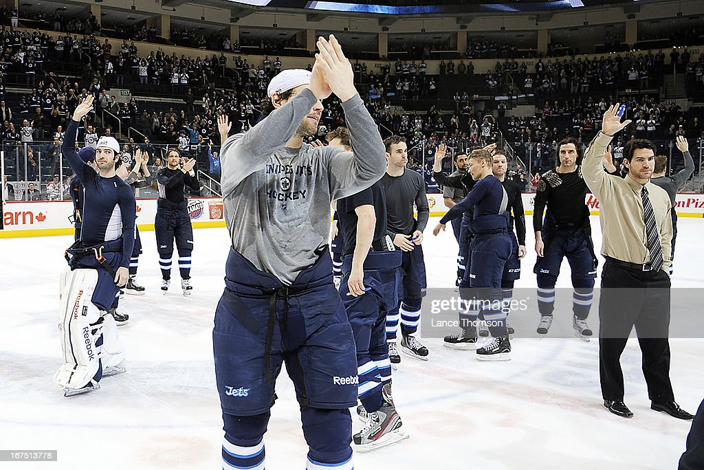 Members of the Winnipeg Jets give a final salute to the home fans from centre ice after their final regular season game against the Montreal Canadiens at the MTS Centre on April 25, 2013 in Winnipeg, Manitoba, Canada. The Habs defeated the Jets 4-2.