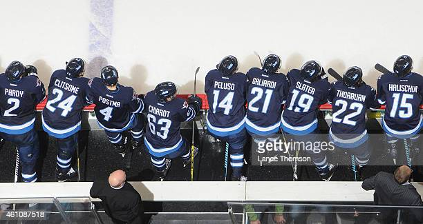 Members of the Winnipeg Jets look on from the bench during NHL action against the Minnesota Wild on December 29 2014 at the MTS Centre in Winnipeg...