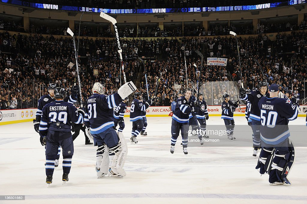 Members of the Winnipeg Jets salute the fans following a 3-2 victory over the Toronto Maple Leafs at the MTS Centre on December 31, 2011 in Winnipeg, Manitoba, Canada.