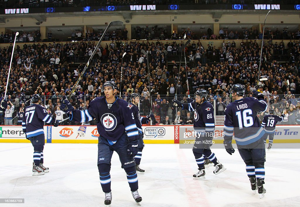 Members of the Winnipeg Jets salute the fans from centre ice following a 3-1 victory over the New Jersey Devils at the MTS Centre on February 28, 2013 in Winnipeg, Manitoba, Canada.