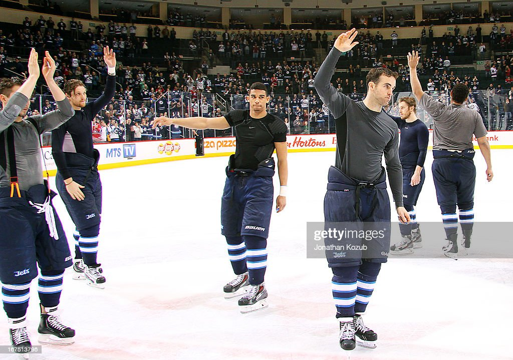 Members of the Winnipeg Jets salute the home fans for the final time at centre ice after a 4-2 loss to the Montreal Canadiens in their regular season finale at the MTS Centre on April 25, 2013 in Winnipeg, Manitoba, Canada.
