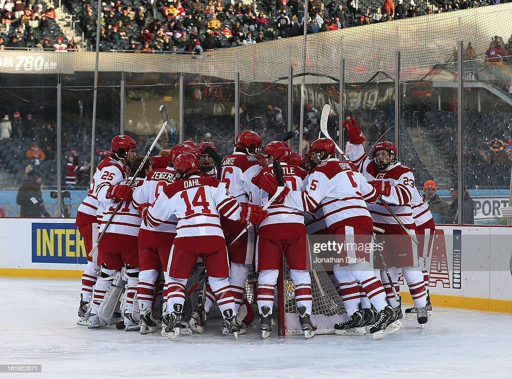 Members of the Wisconsin Badgers huddle before a game against the Minnesota Golden Gophers during the Hockey City Classic at Soldier Field on February 17, 2013 in Chicago, Illinois.