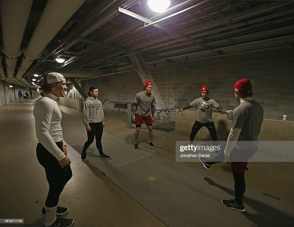 Members of the Wisconsin Badgers play with a soccer ball before taking on the Minnesota Golden Gophers during the Hockey City Classic at Soldier Field on February 17, 2013 in Chicago, Illinois.