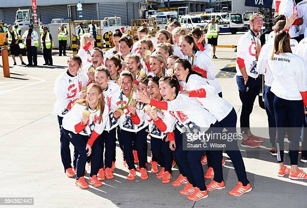 Members of the women's gold medal winning hockey team pose after arriving home at Heathrow Airport on August 23 2016 in London England The 2016...