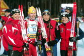 Members of the women's Italian Biathlon team pose for photos after they placed fourth 05 December 2003 in Kontiolahti southeastern Finland at the...