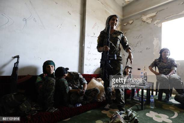 TOPSHOT Members of the Women's Protection Units rest in an abandoned building in Raqa's eastern alSanaa neighbourhood on the edge of the old city on...