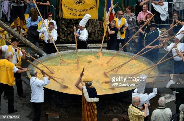 Members of the World Brotherhood of the Huge Omelet create a 6500 egg omelet within a 4 metre diameter frying pan on August 15 2017 in Malmedy Ten...