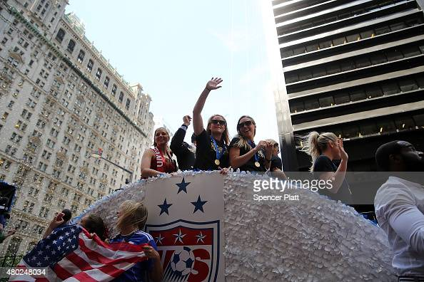 Members of the World Cupwinning US women's soccer team celebrate as they make their way up The Canyon of Heroes along Broadway during a tickertape...