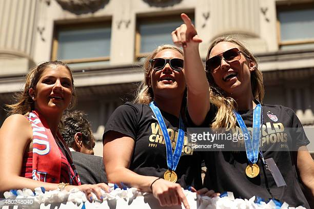 Members of the World Cupwinning US women's soccer team including Hope Solo are viewed as crowds cheer as they make their way up The Canyon of Heroes...