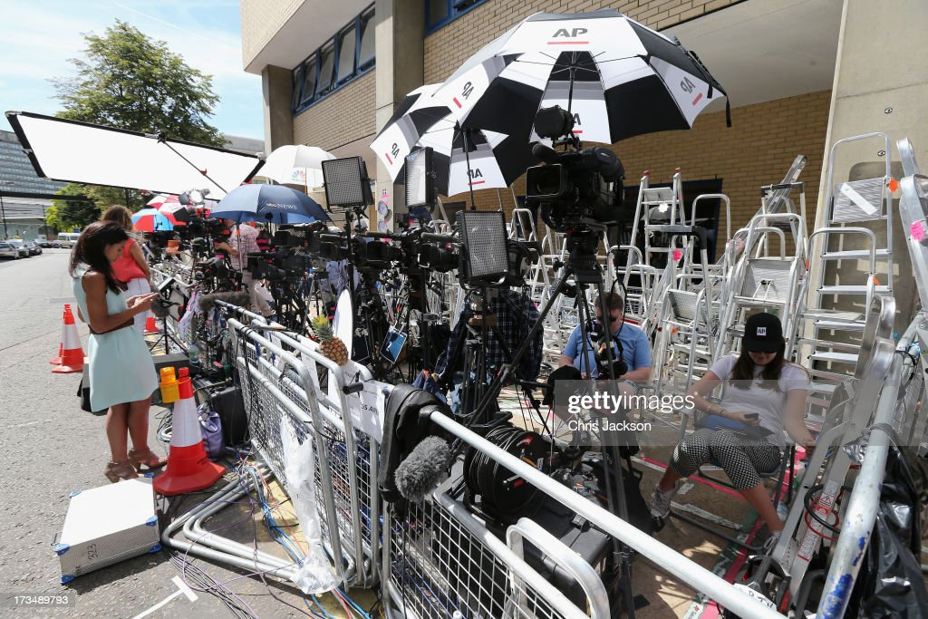 Members of the world media take a break outside the Lindo wing of St Mary's Hospital as the UK prepares for the birth of the first child of The Duke and Duchess of Cambridge on July 14, 2013 in London, England.