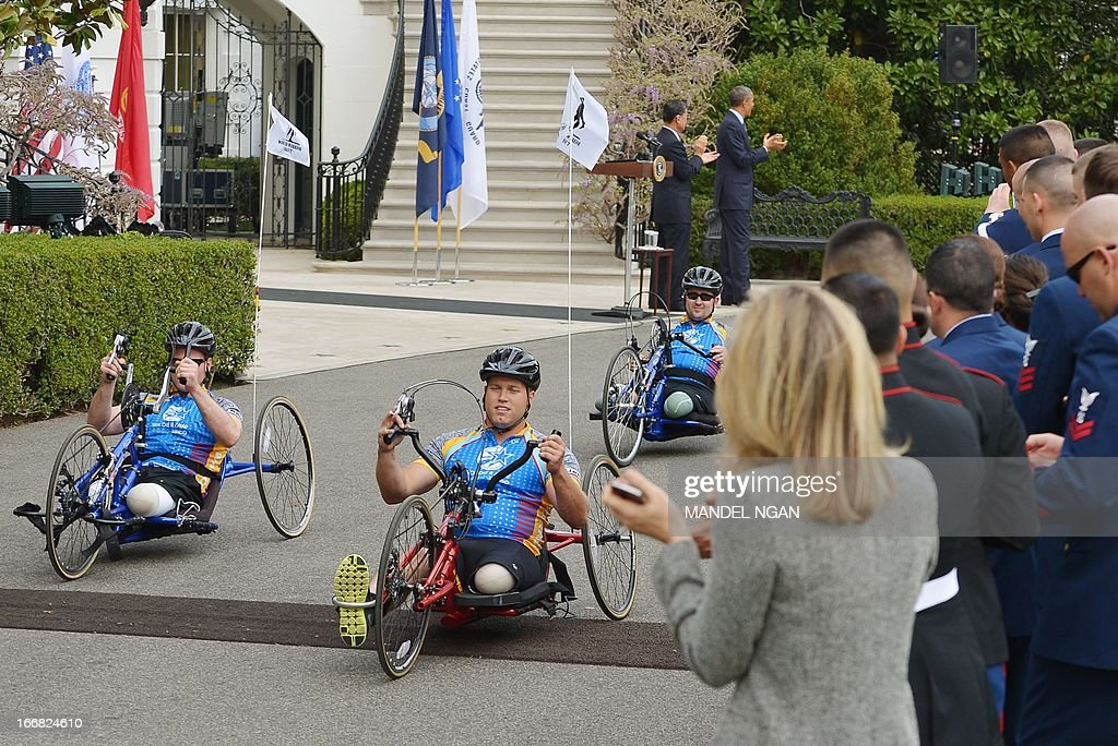 Members of the Wounded Warrior Project's Soldier Ride take a lap on April 17, 2013 around the South Lawn of the White House in Washington, DC. The Soldier Ride is a four-day cycling event for wounded veterans to overcome physical, mental, or emotional wounds. AFP PHOTO/Mandel NGAN