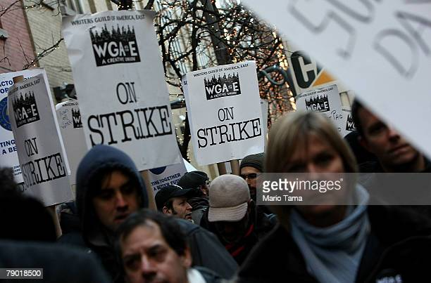 Members of the Writers Guild of America hold picket signs as they rally outside ABC's 'One Life To Live' as part of the writers strike January 16...