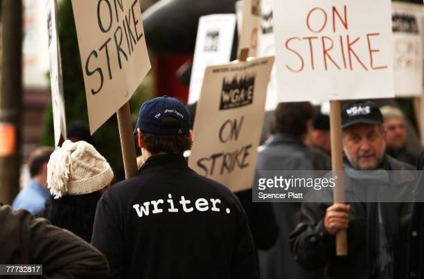 Members of the Writers Guild of America walk the picket line November 6 2007 in front of Silver Cup studios in Queens New York After lastminute talks...