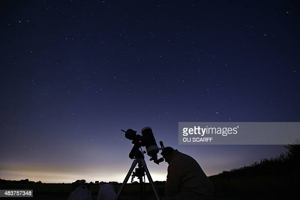 Members of the York Astronomical Society prepare to view the annual Perseids meteor shower in the village of Rufforth near York northern England on...