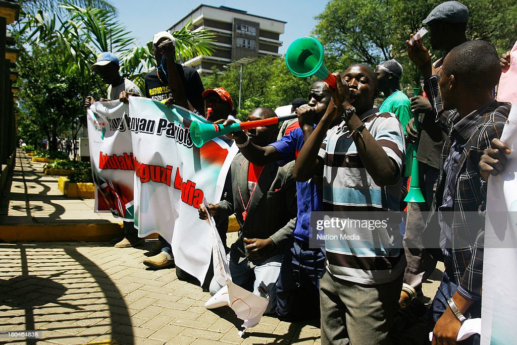 Members of the Young Kenyan Patriot's protest 2013 at the Tom Mboya statue in the Central Business District on January 23, 2013 in Nairbo, Kenya. The group delivered a petition where they accuse the Prime Minister, Mr. Raila Odinga, of treating the Orange Democratic Movement (ODM) party nominations like a family affair.