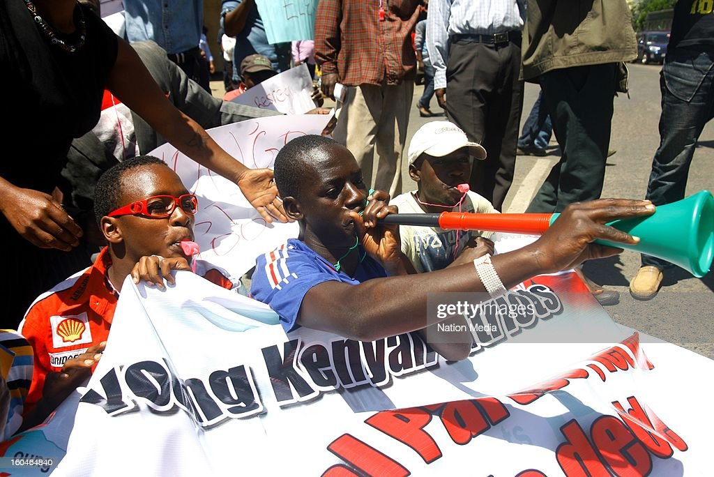 Members of the Young Kenyan Patriot's protest at the Tom Mboya statue in the Central Business District on January 23, 2013 in Nairbo, Kenya. The group delivered a petition where they accuse the Prime Minister, Mr. Raila Odinga, of treating the Orange Democratic Movement (ODM) party nominations like a family affair.
