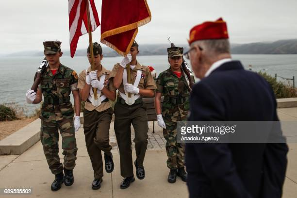 Members of the Young Marines Corporal Tylaw Villacarlos Staff Sergeant Adela Eccli Sergeant Ty Ortega and Private Alondra Ochoa Moreno march in...