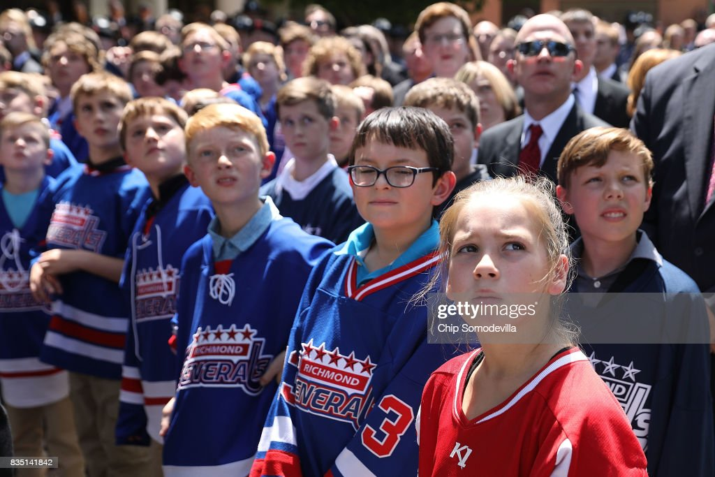 Members of the youth hockey team coached by Trooper-Pilot Berke M.M. Bates attend his funeral at Saint Paul's Baptist Church August 18, 2017 in Richmond, Virginia. Bates and Lieutenant Pilot Jay Cullen were killed when their Bell 407 helicopter crashed into a wooded area while they were monitoring the civil unrest during the white supremacy 'Unite the Right' rally August 12 in Charlottesville, VA.
