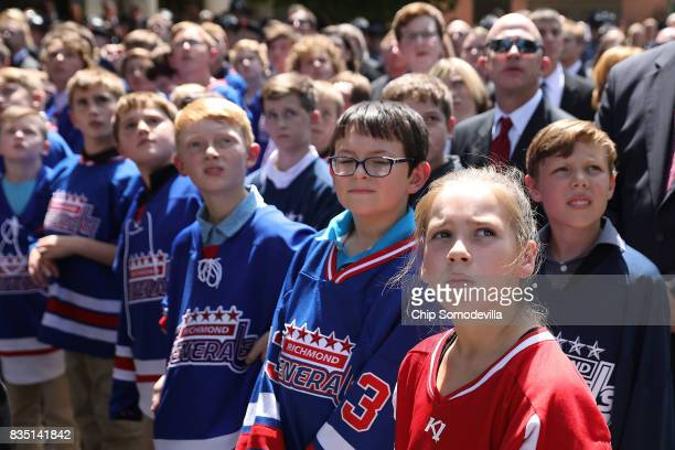 Members of the youth hockey team coached by TrooperPilot Berke MM Bates attend his funeral at Saint Paul's Baptist Church August 18 2017 in Richmond...