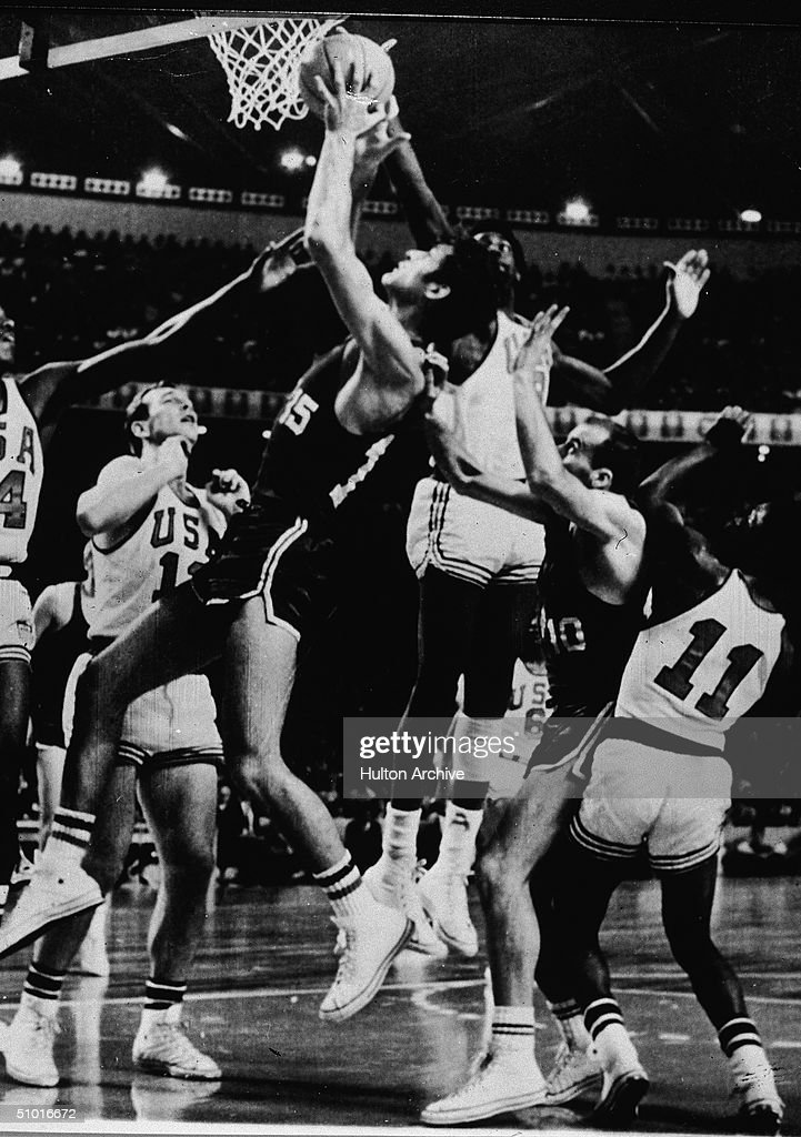 Members of the Yugoslavian (in dark colors) and American national basketball teams struggle to catch a rebound in the Olympics final, Mexico City, Mexico, October 25, 1968. The US team won 65 - 50.
