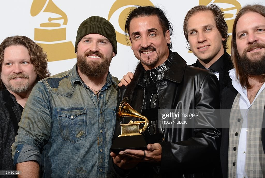 Members of the Zac Brown Band pose with their trophy for best Country album for 'Uncaged' in the press room at the Staples Center during the 55th Grammy Awards in Los Angeles, California, February 10, 2013. AFP PHOTO Robyn BECK