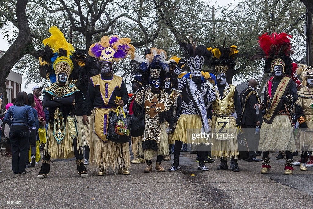 Members of the Zulu Social Aid & Pleasure Club pose while marching in the Zulu Parade on Jackson Avenue, the first parade on the morning of Mardi Gras Day on February 12, 2013 in New Orleans, Louisiana.