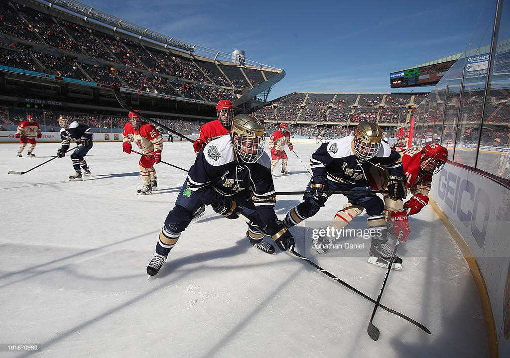 Members of ther Notre Dame Fighting Irish battle with members of the Miami redhawks during the Hockey City Classic at Soldier Field on February 17, 2013 in Chicago, Illinois.