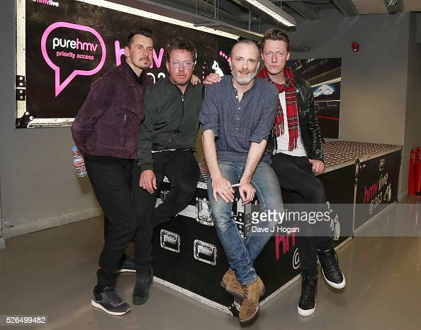 Members of Travis pose for a photo after performing songs from their new album 'Everything At Once' at HMV Oxford Street on April 30 2016 in London...