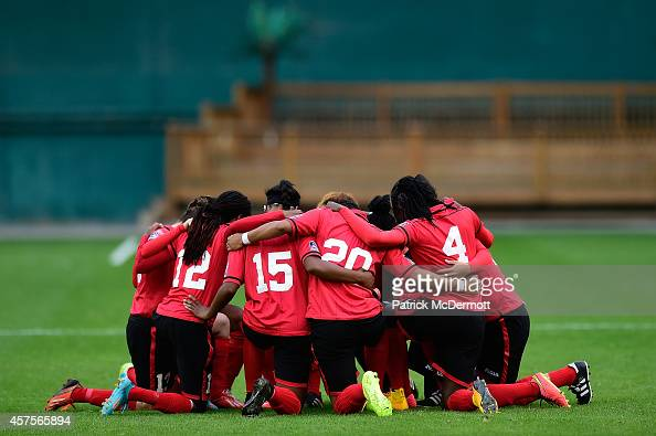 Members of Trinidad and Tobago prepare to play a game against Guatemala during the 2014 CONCACAF Women's Championship at RFK Stadium on October 20...