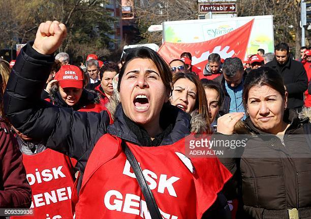 Members of Turkeys Revolutionary Workers Union DISK chant slogans as they march towards the Labour Ministry in Ankara on February 10 2016 to protest...