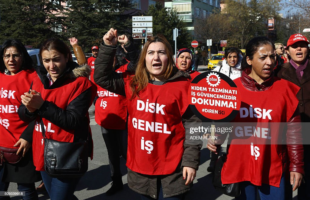 Members of Turkeys Revolutionary Workers Union, DISK, march behind a banner which translates as 'Don't touch my salaray, my rights!' towards the Labour Ministry in Ankara on February 10, 2016 to protest against new salary regulations. / AFP / ADEM ALTAN