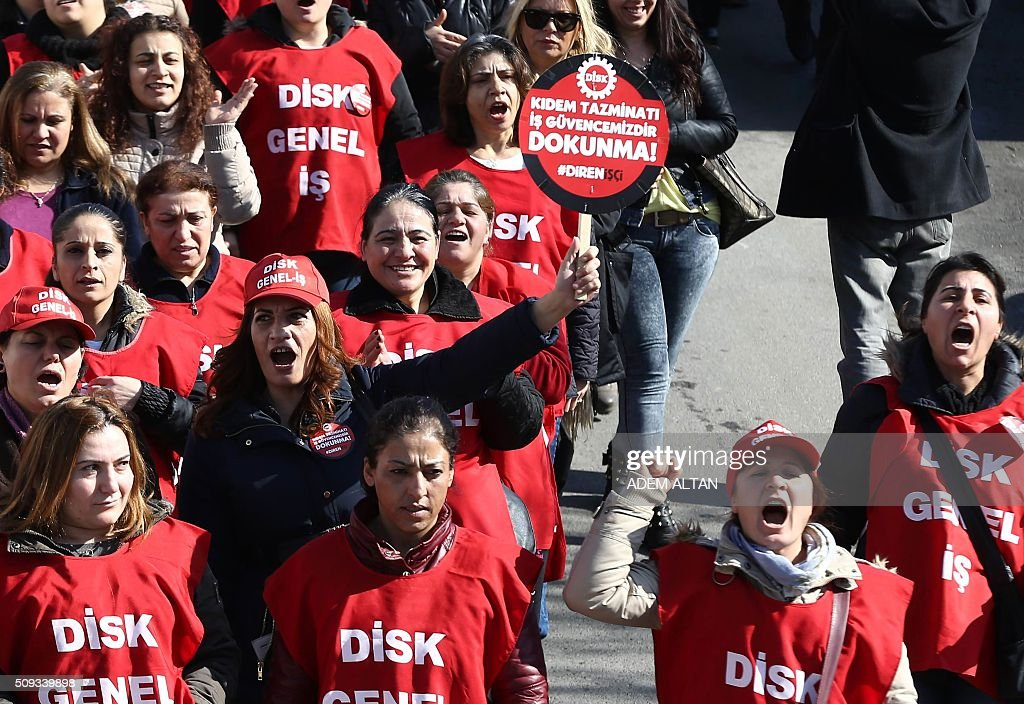 Members of Turkeys Revolutionary Workers Union, DISK, march with a placard which translates as 'Don't touch my salaray, my rights!' towards the Labour Ministry in Ankara on February 10, 2016 to protest against new salary regulations. / AFP / ADEM ALTAN