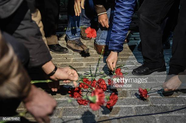 TOPSHOT Members of Turkish medical association lay flowers in Istanbul's tourist hub of Sultanahmet where at least 10 people were killed and 15...