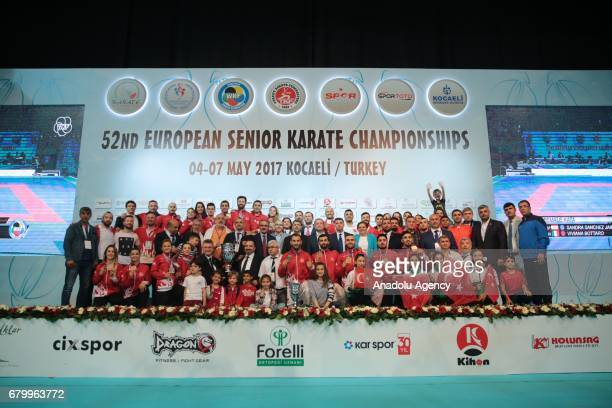 Members of Turkish Men's Kumite team pose after wining men's final match within the 52nd European Karate Championships 2017 at Martyred Police Recep...