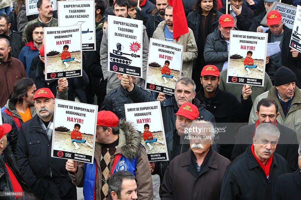 Members of Turkish unions stage a protest against the deployment of patriot missiles by NATO in Turkey on January 20, 2013 In Ankara. The banner reads: 'No to imperialist intervention in Syria'.