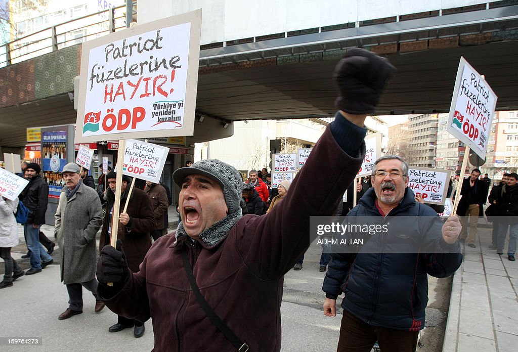Members of Turkish unions stage a protest against the deployment of patriot missiles by NATO in Turkey on January 20, 2013 In Ankara. The banner reads: 'No to Patriots '.