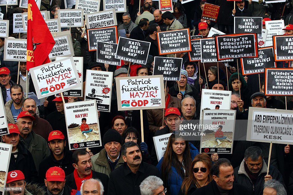 Members of Turkish unions stage a protest against the deployment of patriot missiles by NATO in Turkey on January 20, 2013 In Ankara. The banner reads: 'No to Patriots ' , 'No to imperialist intervention in Syria'. AFP PHOTO / ADEM ALTAN