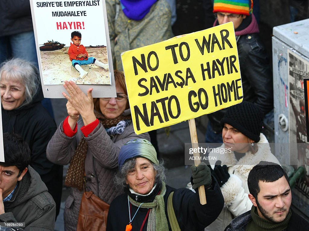 Members of Turkish unions stage a protest against the deployment of patriot missiles by NATO in Turkey on January 20, 2013 In Ankara. 'No to imperialist intervention in Syria'