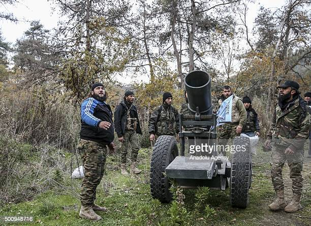 Members of Turkmen Brigades fire artillery as they fight to regain the control of Kizildag which is the most important region in the area in the...