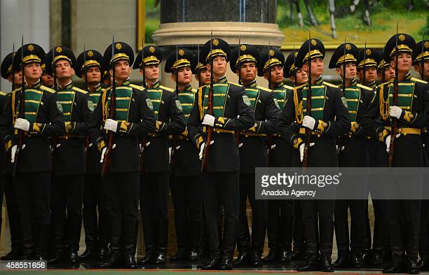 Members of Turkmenistan's honor guard stand in position as they prepare for arrival of Turkish President Recep Tayyip Erdogan at the Oguzhan...