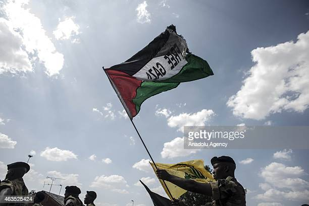 Members of Umkhonto we Sizwe the armed wing of the African National Congress hold up a Free Gaza flag as they await the arrival of Leila Khaled a...