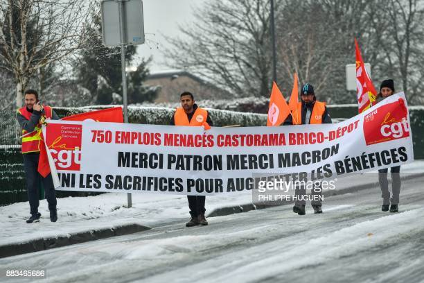 Members of unions gather near the Castorama's headquarters in Templemars on December 1 to protest against the announce of around 500 job cuts in...