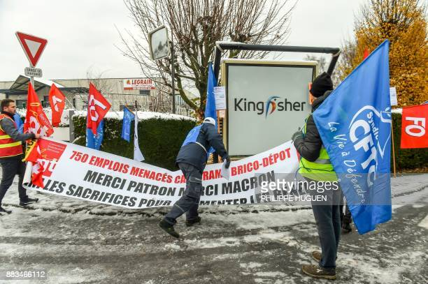 Members of unions gather near the KingFisher group's headquarters in Templemars on December 1 to protest against the announce of around 500 job cuts...