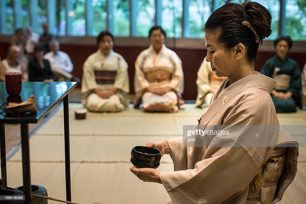 Members of Urasenke, a Japanese tea ceremony school, attend the first tea ceremony of the new year at a hotel in Sao Paulo, Brazil, on January 13, 2013. The school in Brazil has about 300 members and this year celebrates its 59th anniversary. AFP PHOTO/YASUYOSHI CHIBA