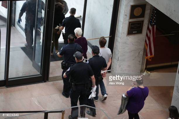 Members of US Capitol police arrest activists who were protesting against the Republican health care repealandreplace legislation in the Hart Senate...