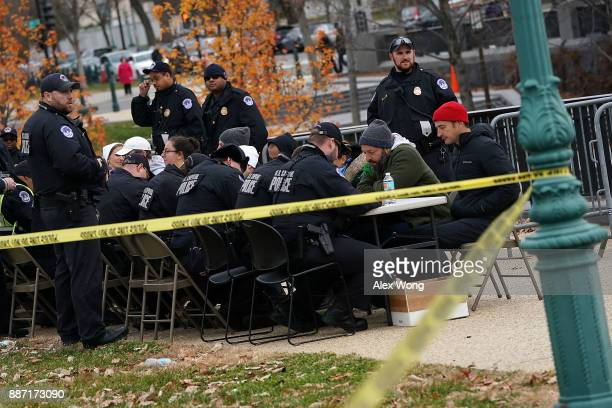 Members of US Capitol Police take down information of immigration activists who are arrested during a protest on the ground of the US Capitol...