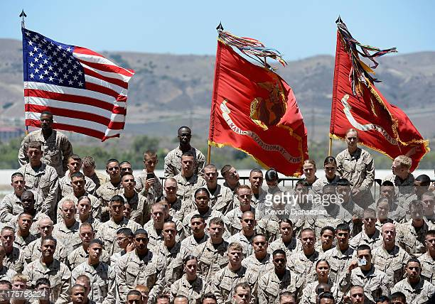 Members of US marine Corps listens to US President Barack Obama speech during his visit at Camp Pendleton Marine Corps base with troops and their...