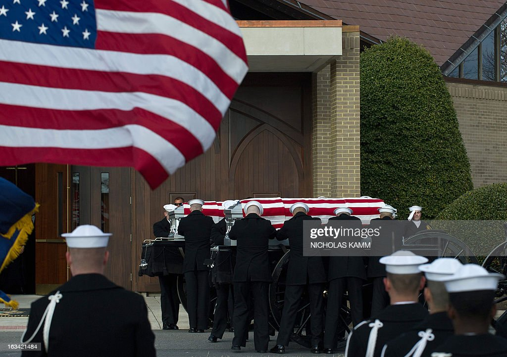 Members of US Navy ceremonial teams place the caskets of two unknown sailors who were killed in 1862 when the ironclad USS Monitor sank off the coast of North Carolina during the Civil war at a funeral service at Arlington National Cemetery on March 8, 2013 in Arlington, Virgina. The sailors' remains, recovered when a portion of the ship was raised eleven years ago, were buried with full military honors. AFP PHOTO/Nicholas KAMM