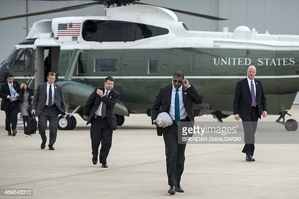 Members of US President Barack Obama's US Secret Service detail arrive at Gary Chicago International Airport on October 2 2014 in Gary Indiana Obama...